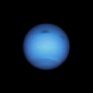 Dark Storm on Neptune Reverses Direction, Possibly Shedding a Fragment