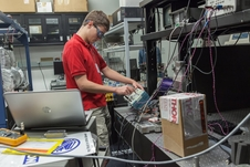 NASA Goddard intern Robert Buttles adjusts equipment used for the eLISA mission.