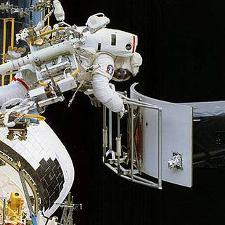 photo of astronaut working on Hubble Space Telescope in space