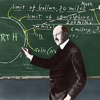 Photograph of Robert Goddard at blackboard