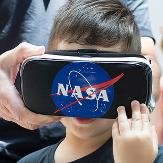 photo of 4-year-old boy with virtual reality goggles