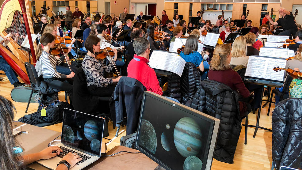 The National Philharmonic Orchestra rehearses for an upcoming performance that will blend classical music and images of our solar system