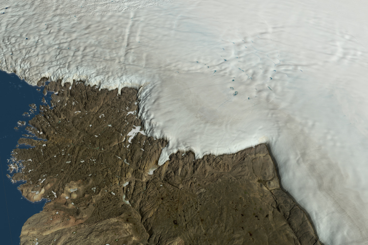 Image of a large meteorite impact crater hiding beneath the ice of northwest Greenland