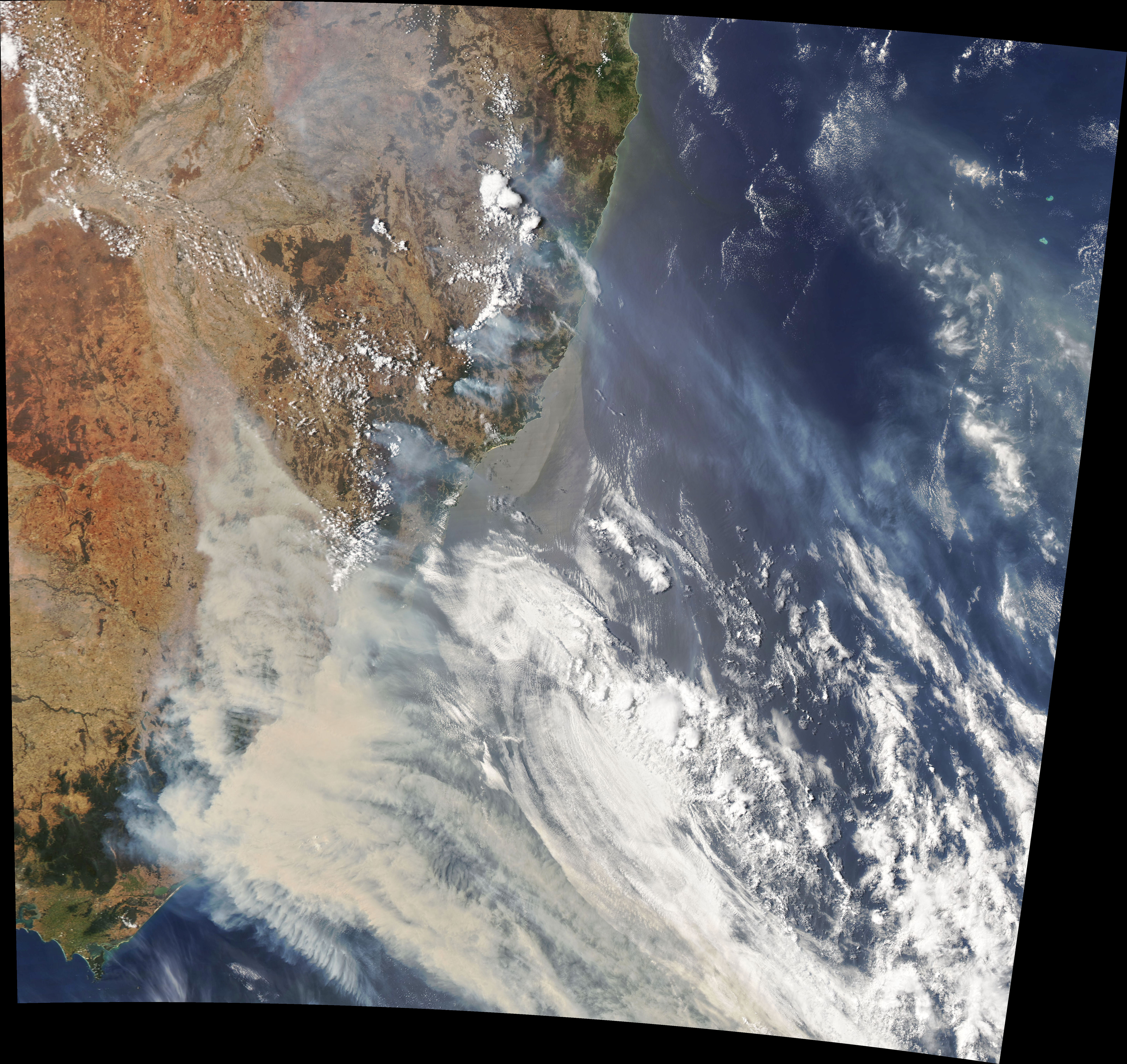 Moderate Resolution Imaging Spectroradiometer (MODIS) on NASA's Aqua satellite. Smoke has a tan color, while clouds are bright white.
