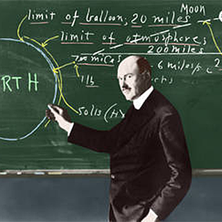 Image of Robert Goddard at chalkboard with mathematical formulas
