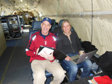 Photo of two teachers in plane on IceBridge mission.