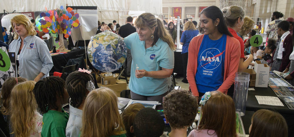 Photo of visitors at the exhibits at NASA's Earth Day event at Union Station in Washington, DC on Friday, April 22, 2016