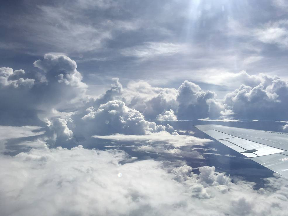 Photo of clouds taken from inside DC-8