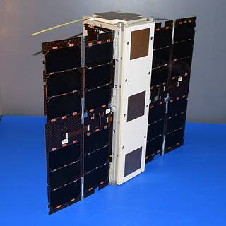 Photo of the Microwave Radiometer Technology Acceleration (MiRaTA) satellite