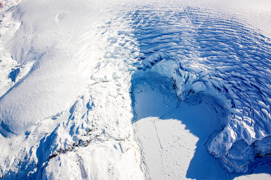 Image of a heart-shaped calving front of a glacier in northwest Greenland, as seen during an Operation IceBridge flight on Mar. 27, 2017.