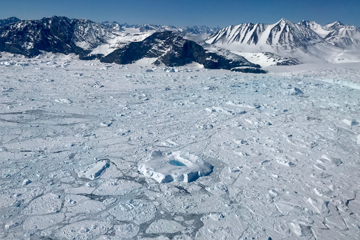 Photograph of all ice types in the fjord of the Kangerdlugssuaq Glacier, as well as the glacier front