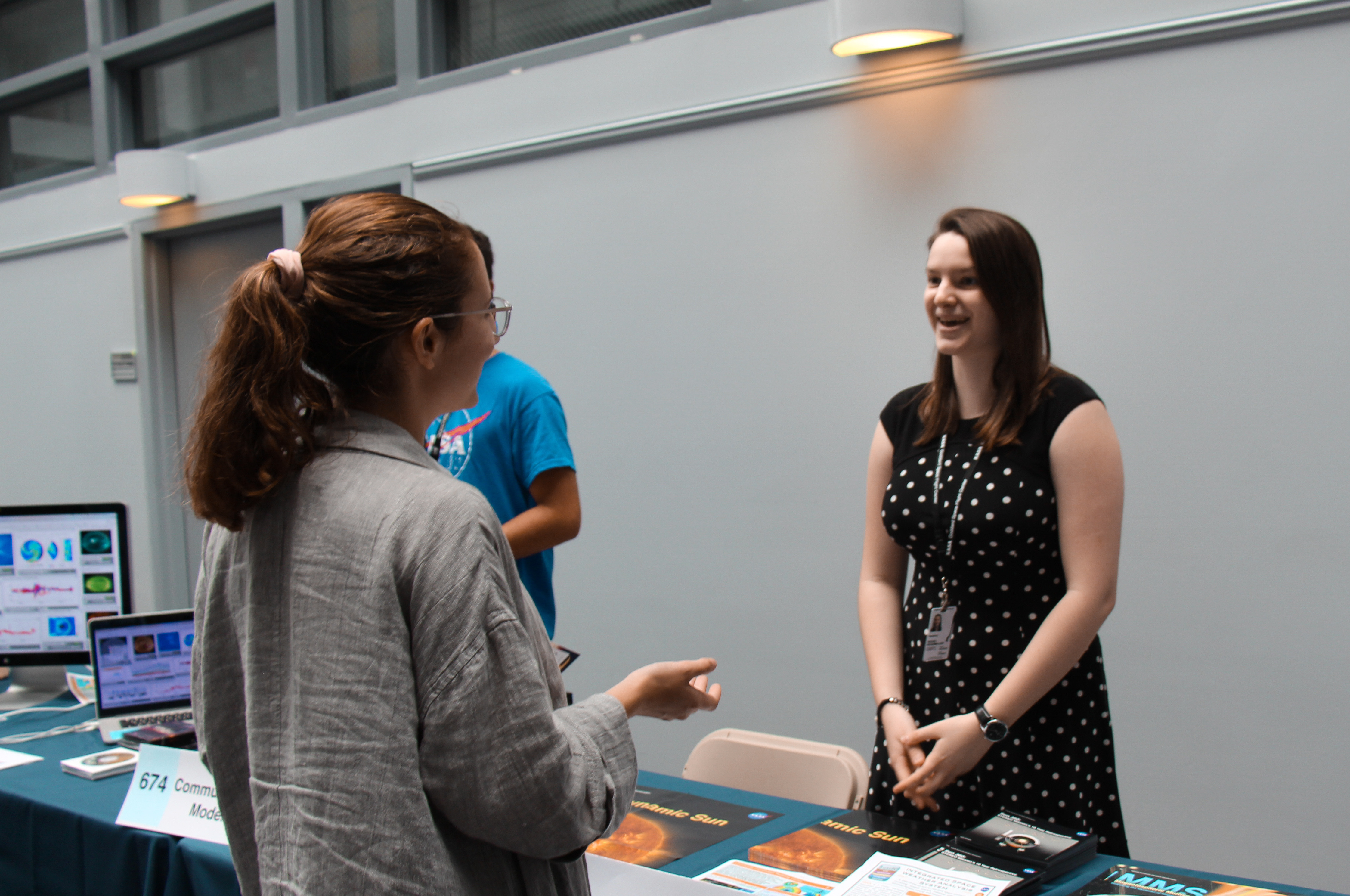 Photo of two Science Jamboree participants talking at display