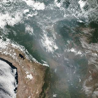 Smoke from the fires raging in in the Amazon basin has created a shroud that is clearly visible across much of the center of South America.
