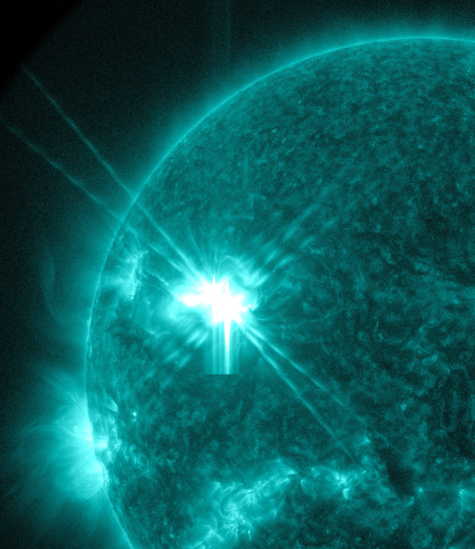 The bright flash of an X1.6-class flare can be seen on the right side of the sun in this image captured by NASA's Solar Dynamics Observatory.