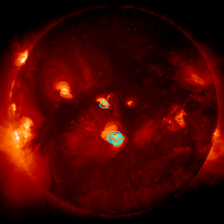 FOXSI's observations of hard X-rays are shown in blue, superimposed over a soft X-ray image of the Sun from JAXA and NASA's Hinode solar-observing satellite