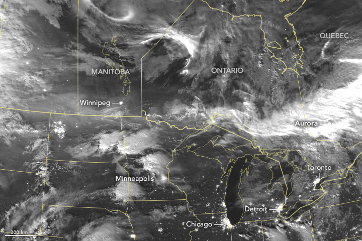 Black and white Suomi NPP satellite image of atmospheric light over the Great Lakes region of the United States