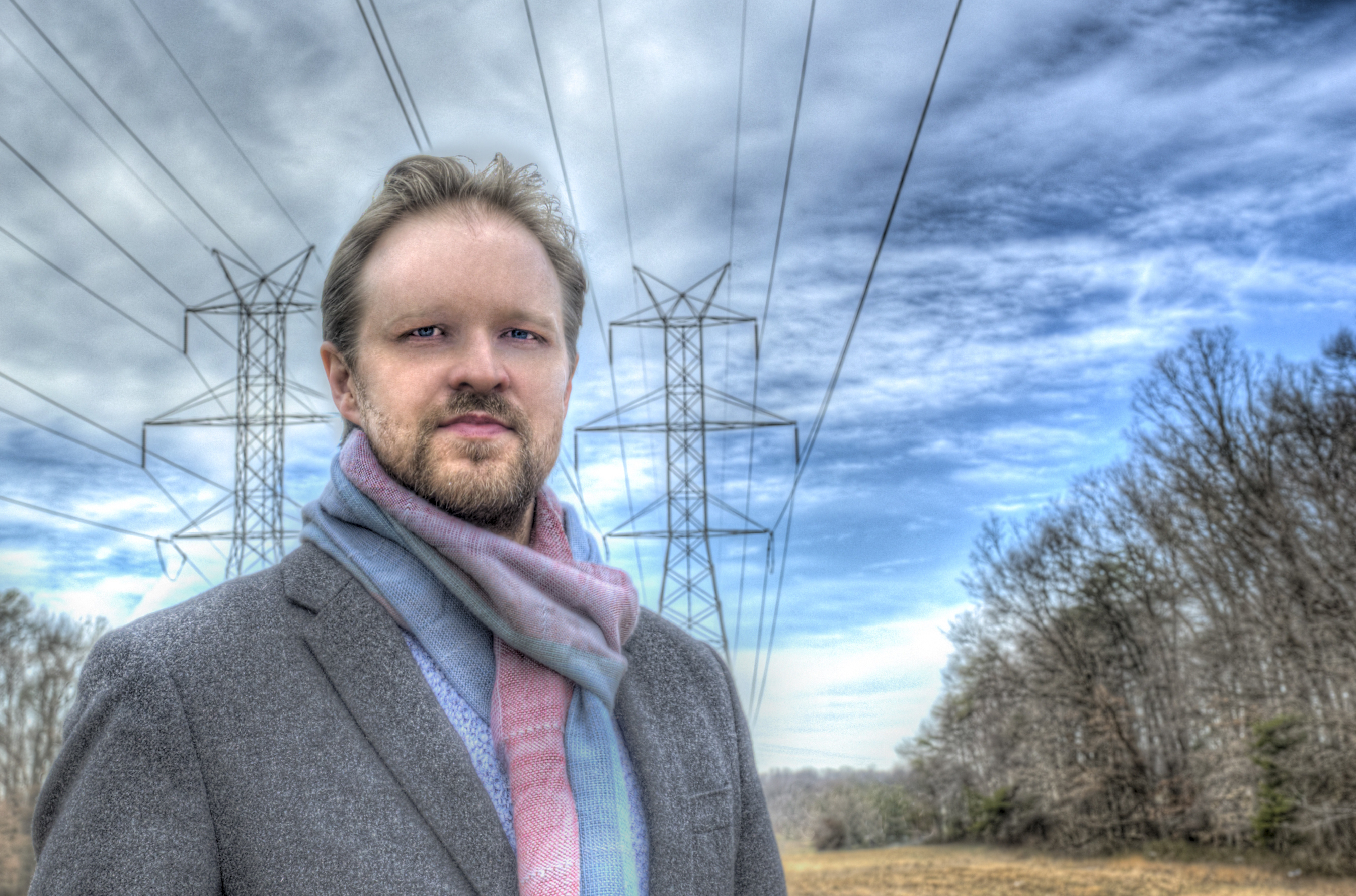 Photo of Antti Pulkkinen standing under power lines