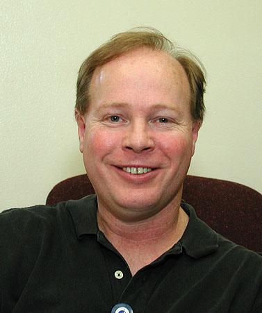 Bio - John W Mitchell