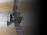 artist concept of juno spacecraft orbiting jupiter