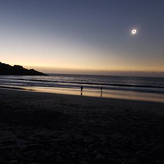 Photo of Fauchez on a beach in Chile witnessing the total solar eclipse