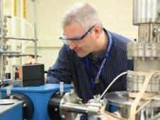 Perry Gerakines measures how much far-ultraviolet light an ice sample absorbs using a spectrometer.