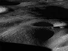 This is a view from NASA's Lunar Reconnaissance Orbiter spacecraft across the north rim of Cabeus crater. The leaping dust behavior may be observed on the moon in places like this where sunlit areas are close to shaded regions.