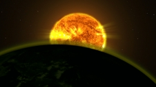 Photo of This illustration shows a star's light illuminating the atmosphere of a planet.