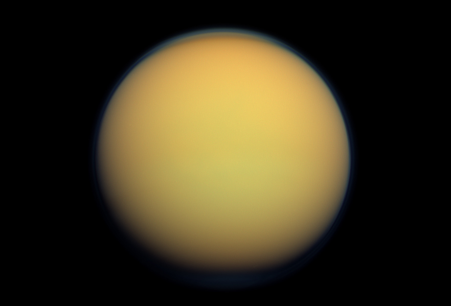 Titan's atmosphere makes Saturn's largest moon look like a fuzzy orange ball in this natural-color view from the Cassini spacecraft. Cassini captured this image in 2012.