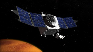 Artist conception of the MAVEN spacecraft orbiting the planet Mars.