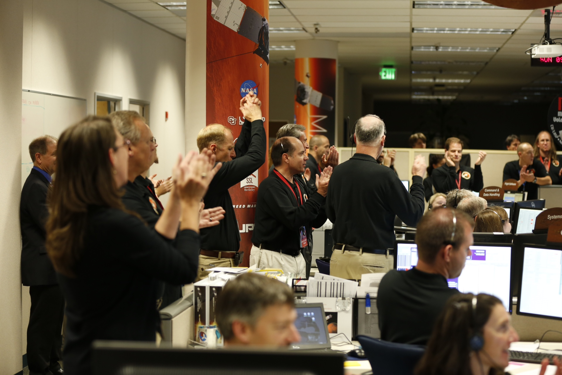 Members of the mission team at the Lockheed Martin Mission Support Area in Littleton, Colorado, celebrate after successfully inserting NASA's Mars Atmosphere and Volatile Evolution (MAVEN) spacecraft into orbit around Mars at 10:24 p.m. EDT Sunday, Sept. 21.