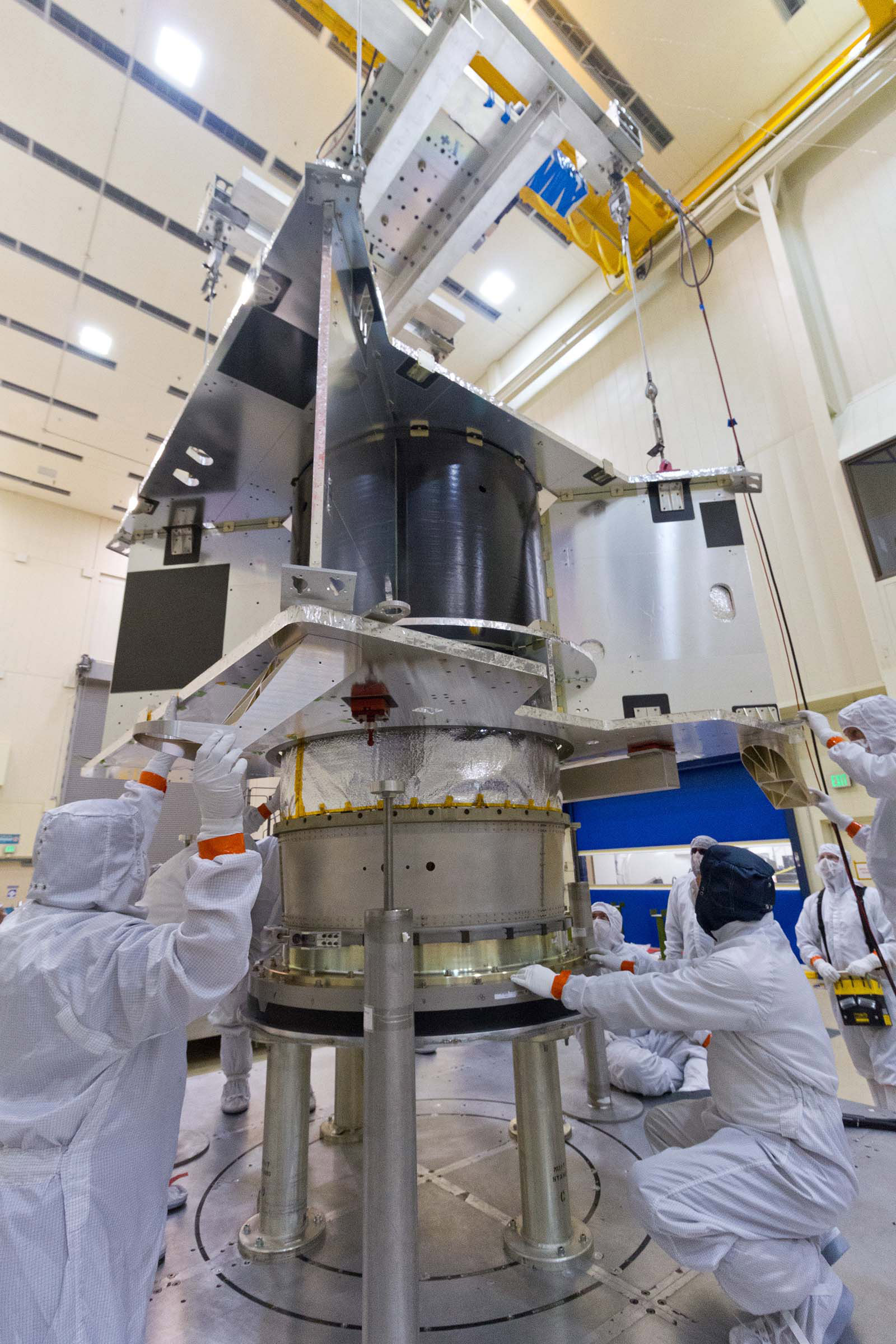 he OSIRIS-REx spacecraft core structure is successfully lowered and mated to the hydrazine propellant tank and boat tail assembly at Lockheed Martin, Denver, Colo.