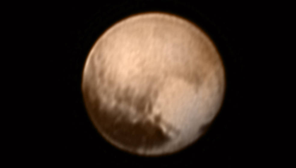 Photo of Image of Pluto showing a heart-shaped area that is lighter than surrounding material.