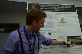 Photo of Sean McCLoat explaining his poster