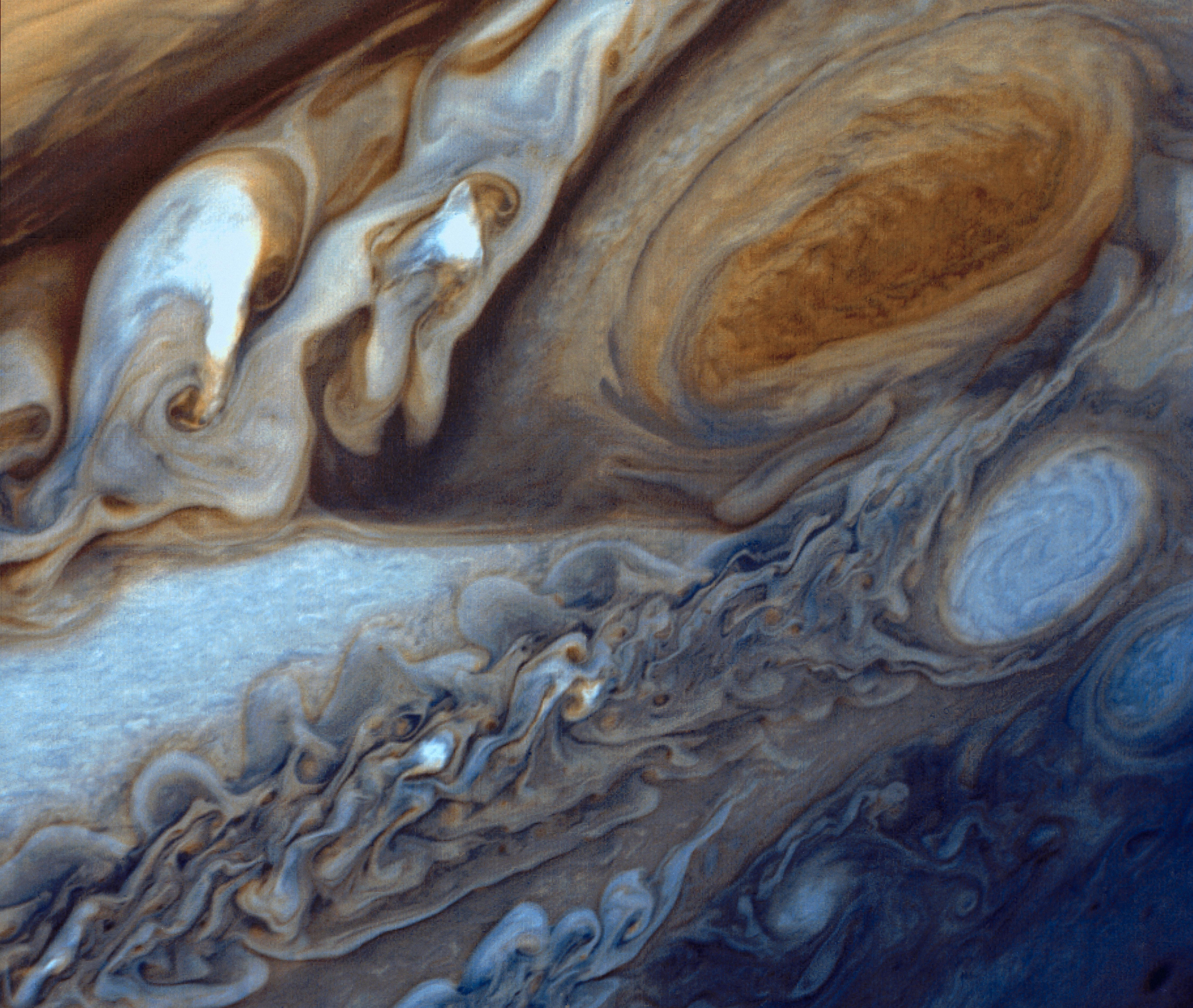 Photo of View of Jupiter's Great Red Spot and swirling clouds near it, taken by Voyager