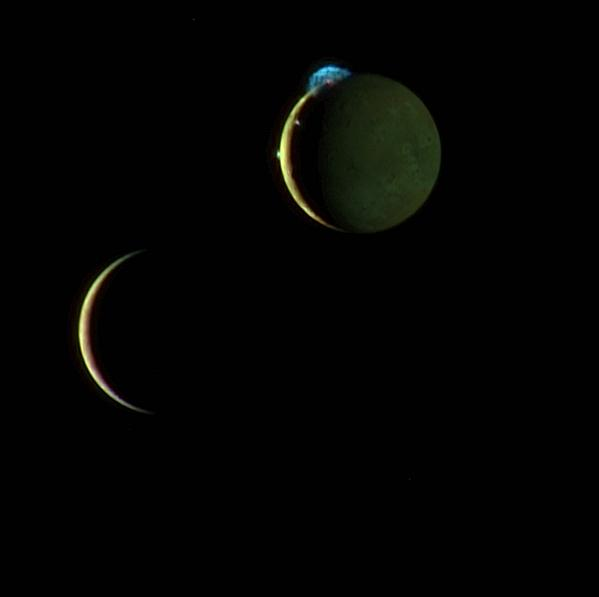 Photo of A composite image of Io and Europa taken in 2007 by the New Horizons spacecraft. Io is shown at the top with three volcanic plumes visible.