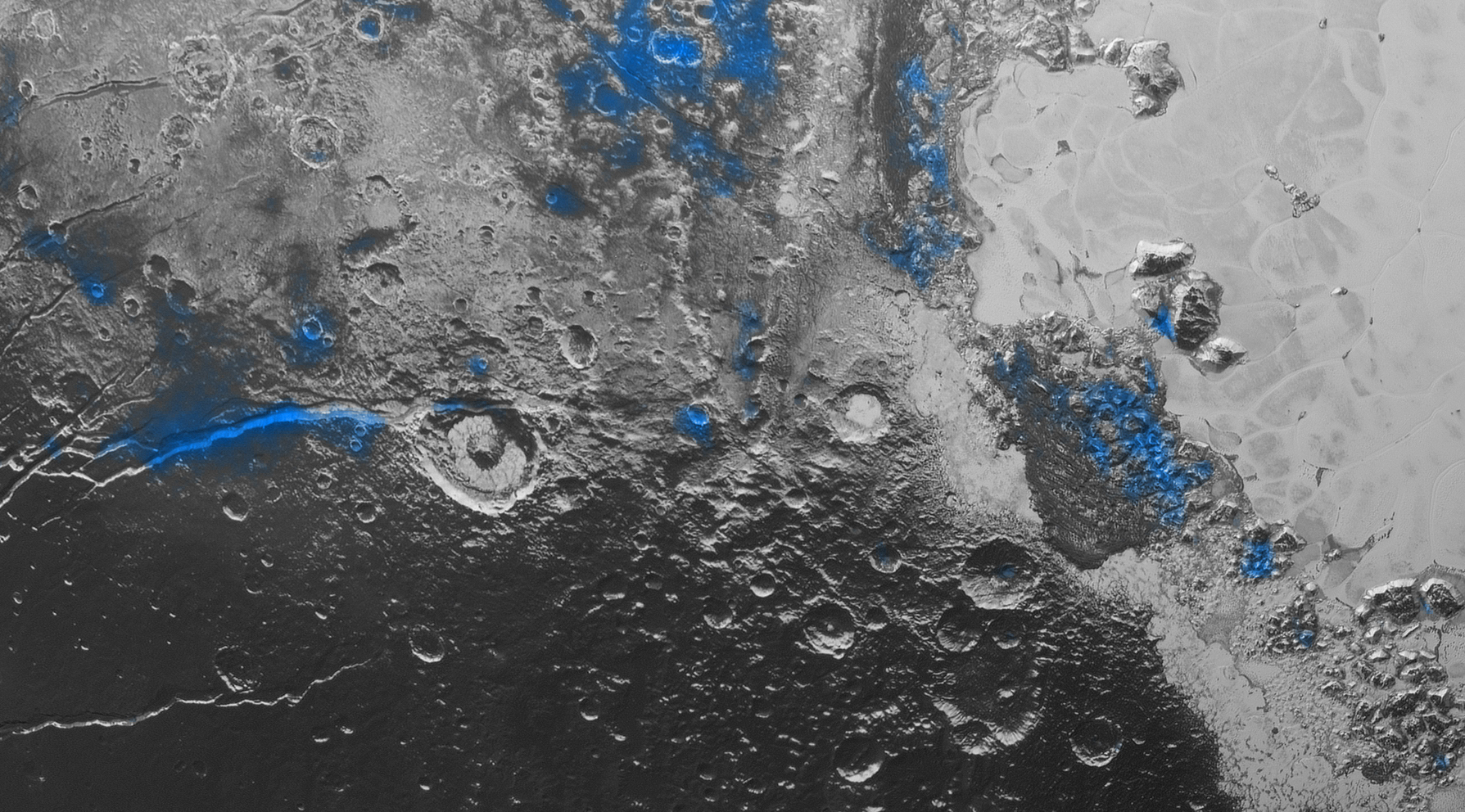 Photo of Image of Pluto with blue areas that represent the locations of exposed water ice