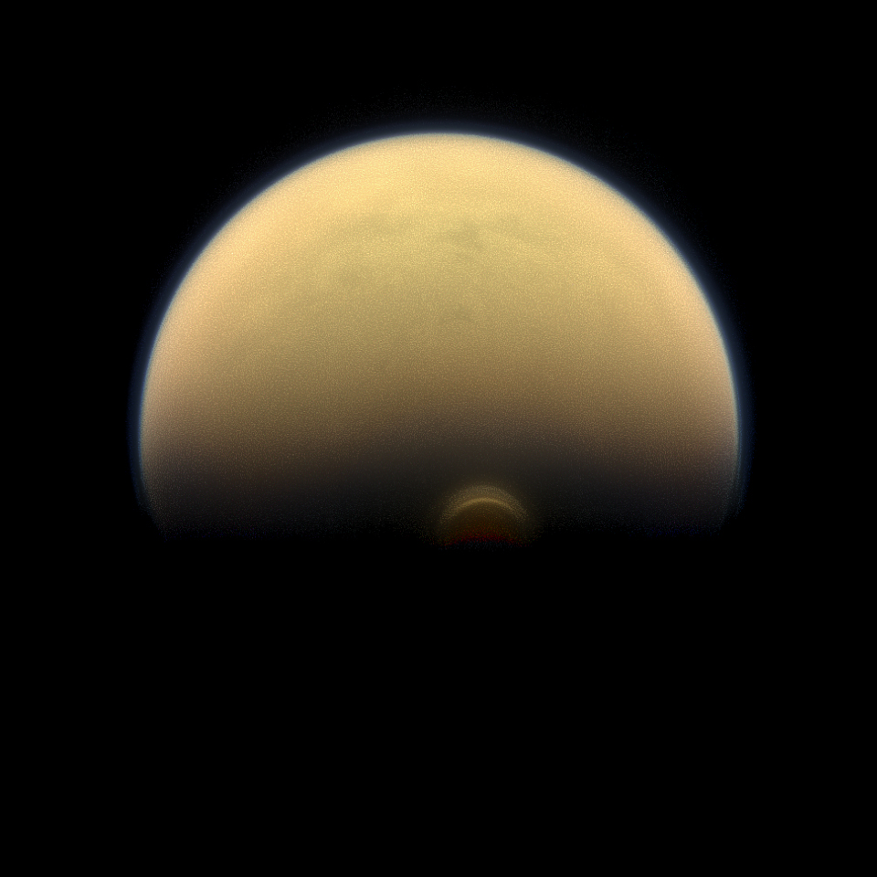 Photo of An image of Saturn's moon Titan. A cloud system over the south pole is highlighted.