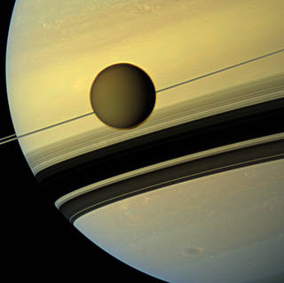 An image of Saturn with its largest moon, Titan