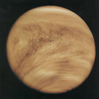 An ultraviolet image of Venus taken by NASA's Pioneer-Venus Orbiter in 1979. Venus is striped by light and dark areas indicating that an unknown absorber is operating in the planet's top cloud layer.