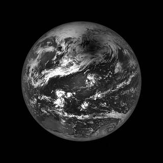 A black-and-white image of the moon's shadow on Earth, as seen by NASA's Lunar Reconnaissance Orbiter