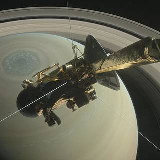Image compilation showing the Cassini spacecraft with Saturn behind it