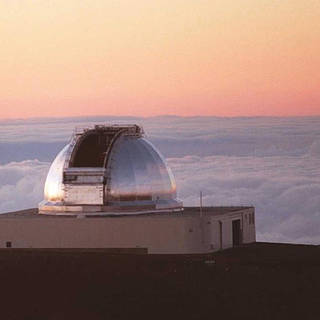 Photo of NASA's Infrared Telescope Facility looking out over cloudtops