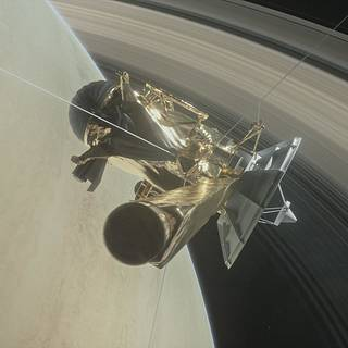Illustration showing NASA's Cassini orbiter between Saturn and its rings