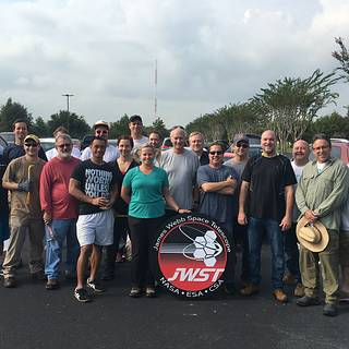 photo of JWST employees posed in Houston with JWST logo, ready to help with hurricane relief