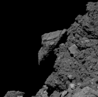 Image of asteroid Bennu's boulder-covered surface.